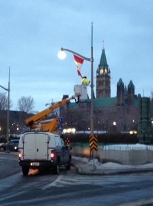 Putting up French and Canadian flags to prepare for the French PM's visit.