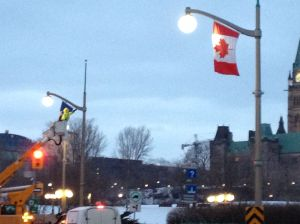 Putting up French and Canadian flags to prepare for the French PM's visit