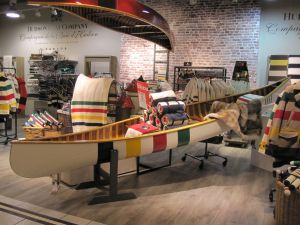 Hudson's Bay Company is known for their point blankets with blue, yellow, red, and green stripes.